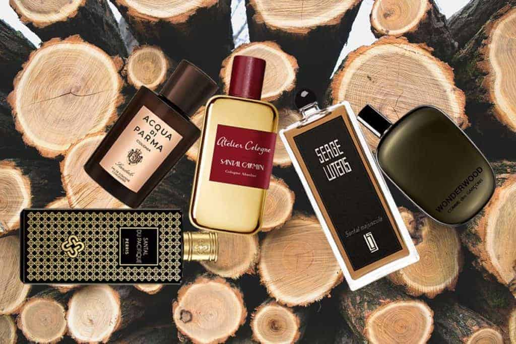 picture of cologne bottles next to logs